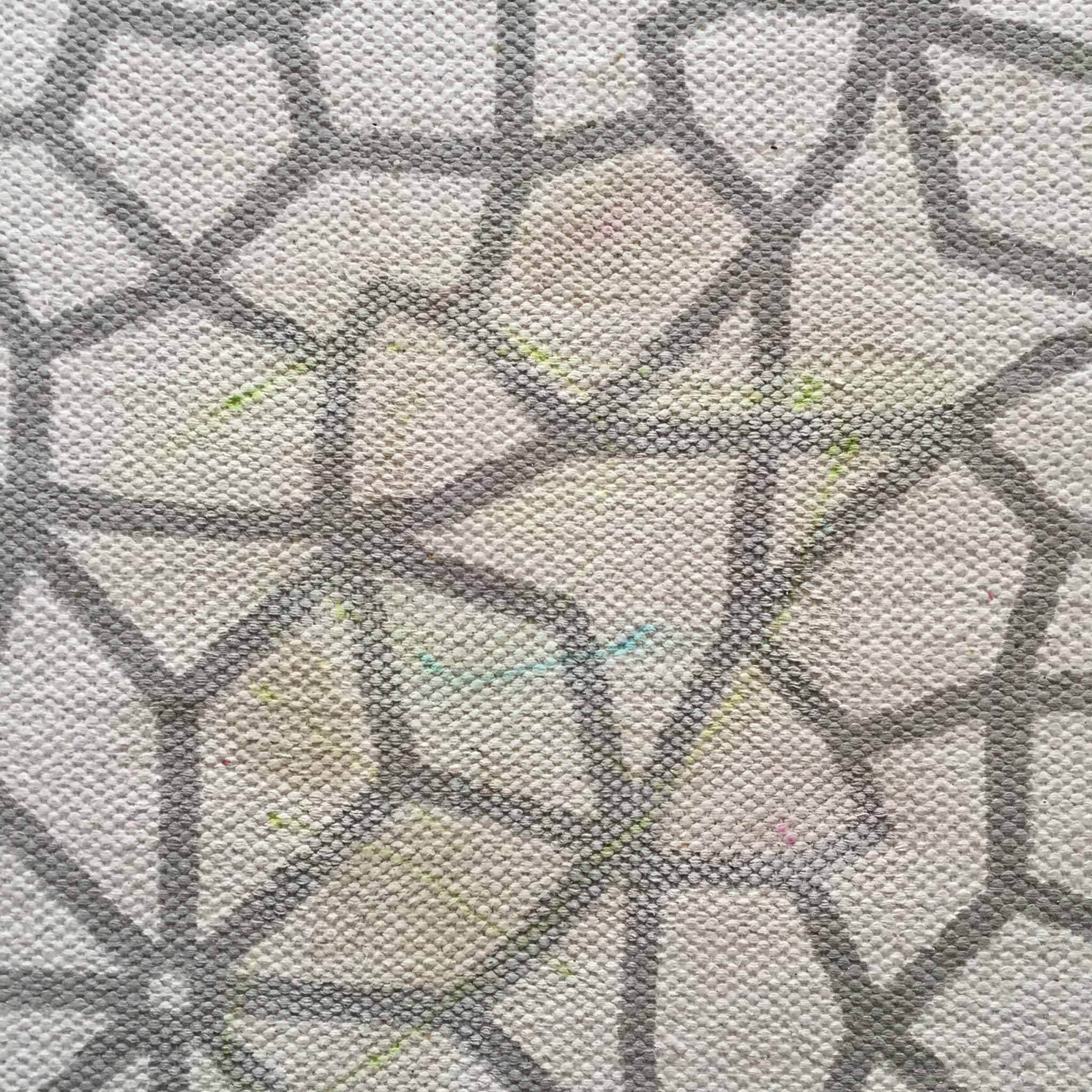 Grey and cream rug with pen scribbles