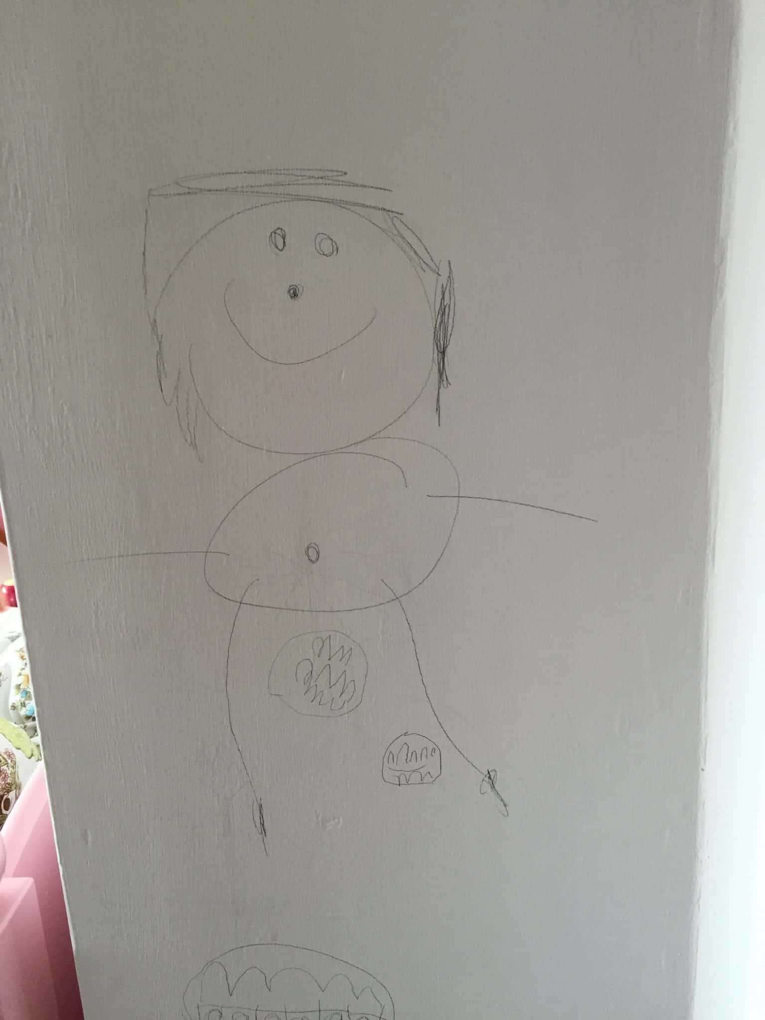 Four year old's pencil drawing on the wall