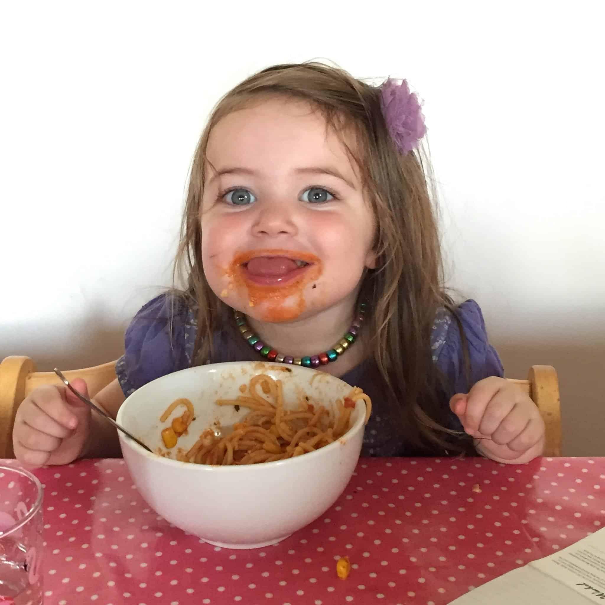 Thea enjoying spaghetti
