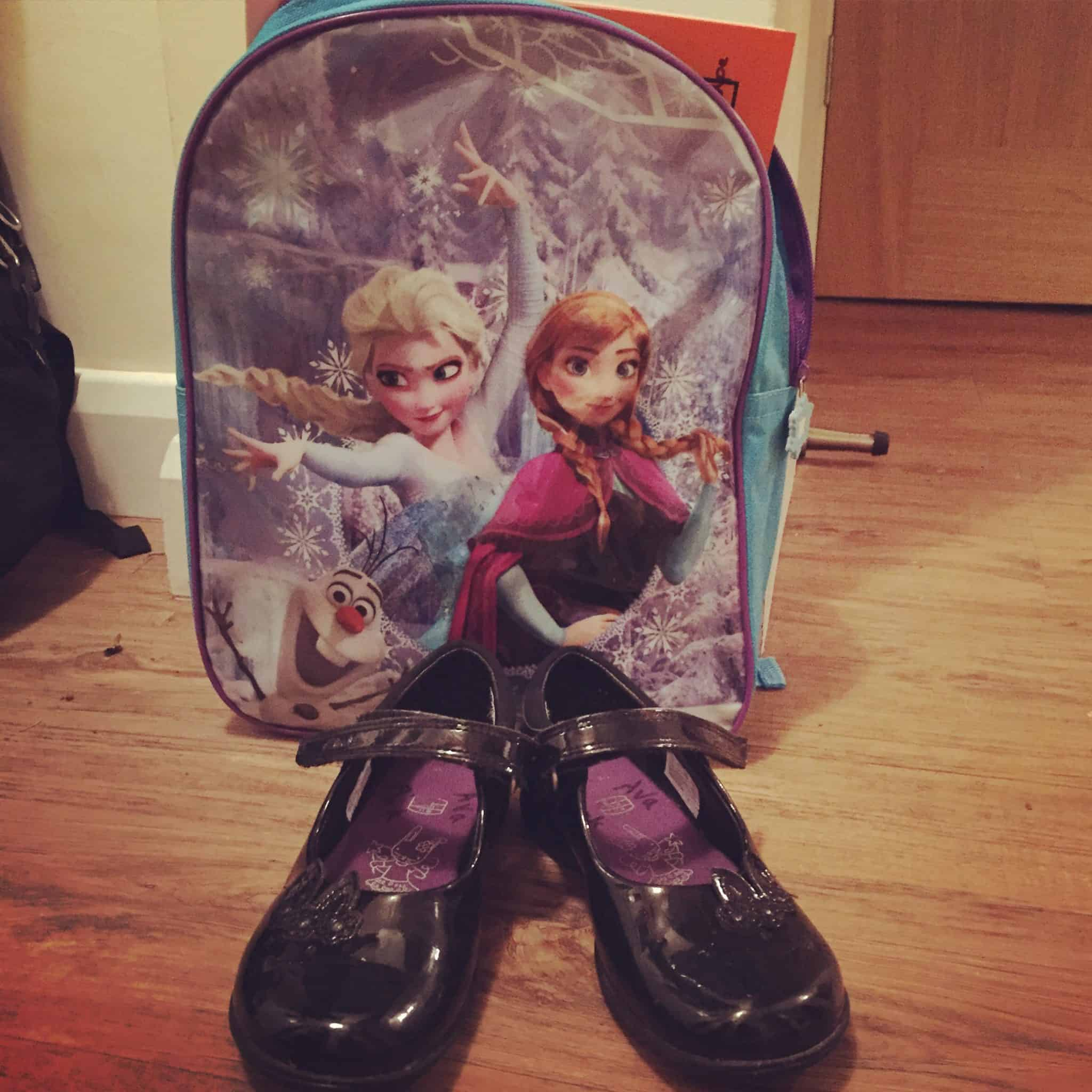 Ava's flashing Clark's shoes and Frozen backpack