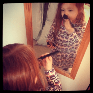 Ava putting on make-up