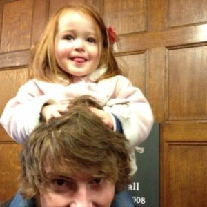 Ava on Ryan's shoulders aged two