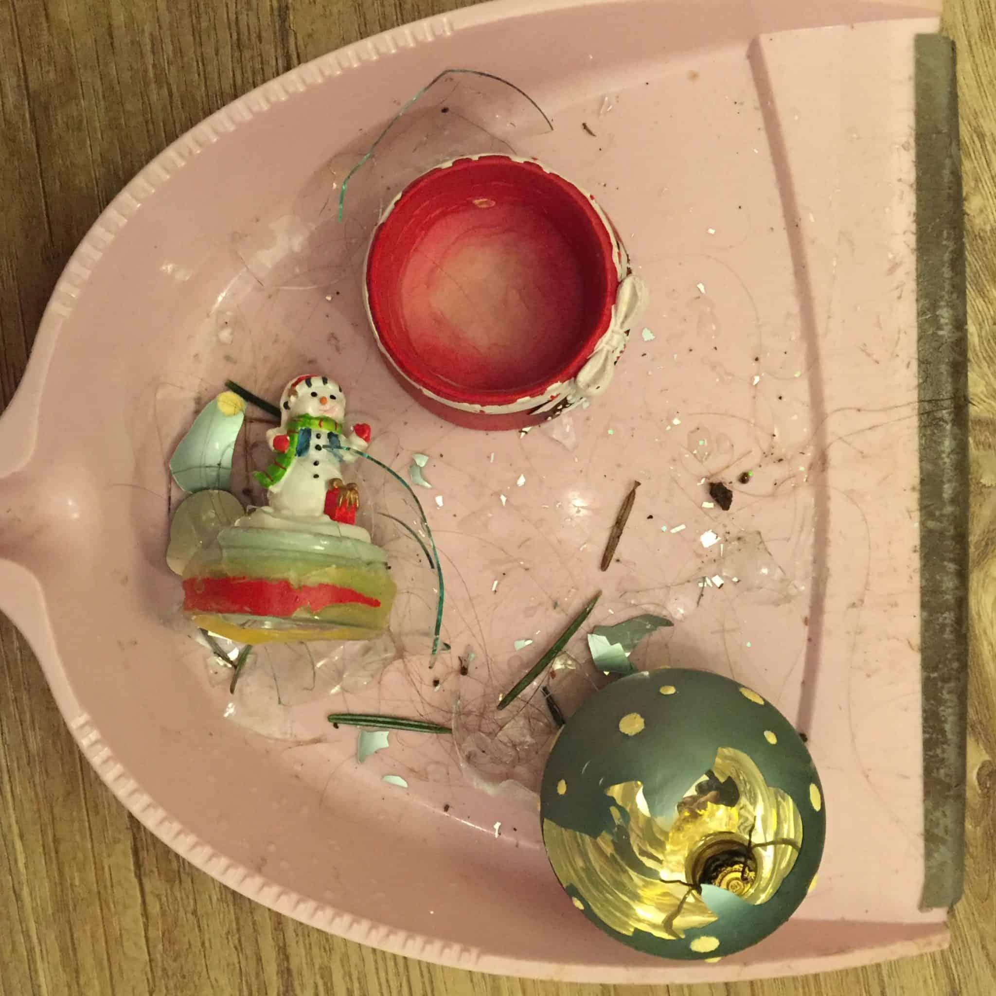 Broken bauble and snow globe