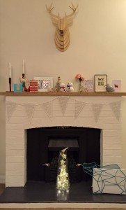 Fireplace with snowflake bunting and star lights
