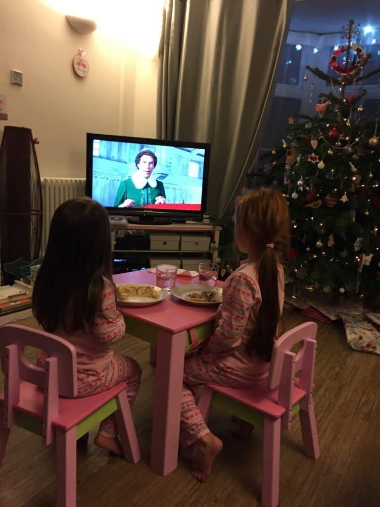 Thea and Ava watching Elf