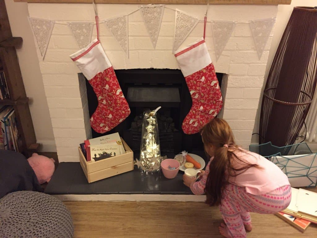 Ava putting goodies out for Father Christmas