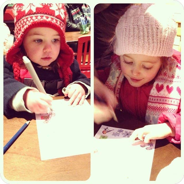 Thea and Ava 'writing' their letters to Father Christmas