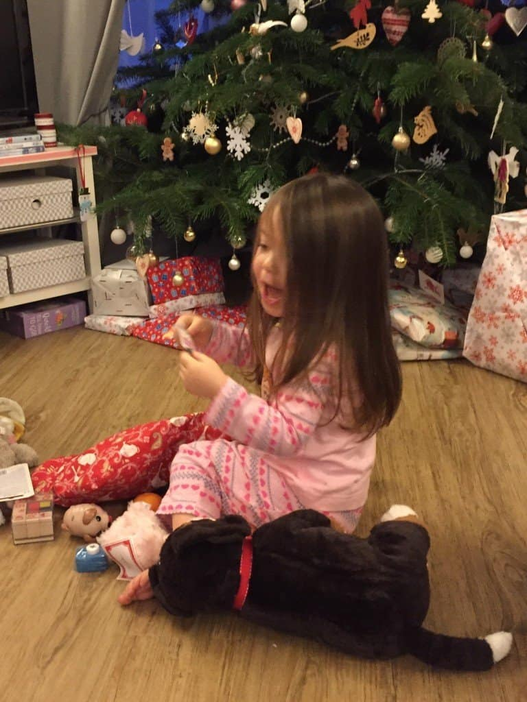Thea opening her Christmas stocking