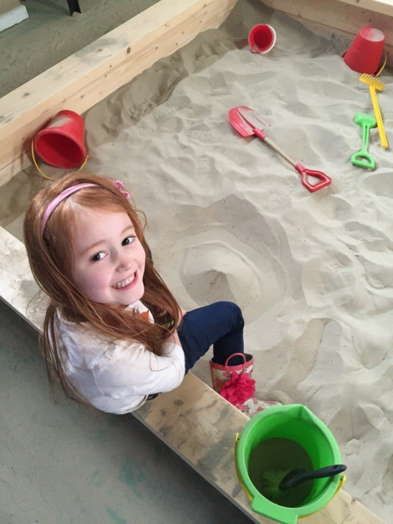 Ava in the sandpit at Green Dragon Eco Farm