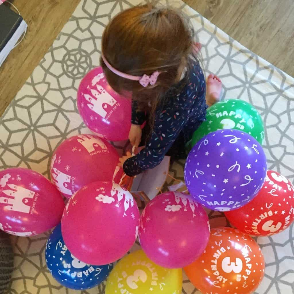 Ava with balloons