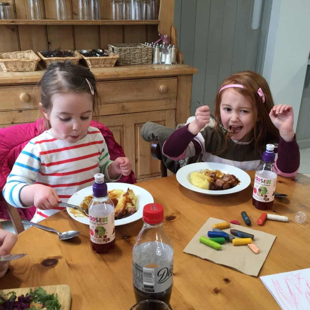 Thea and Ava enjoying their sausage and mash