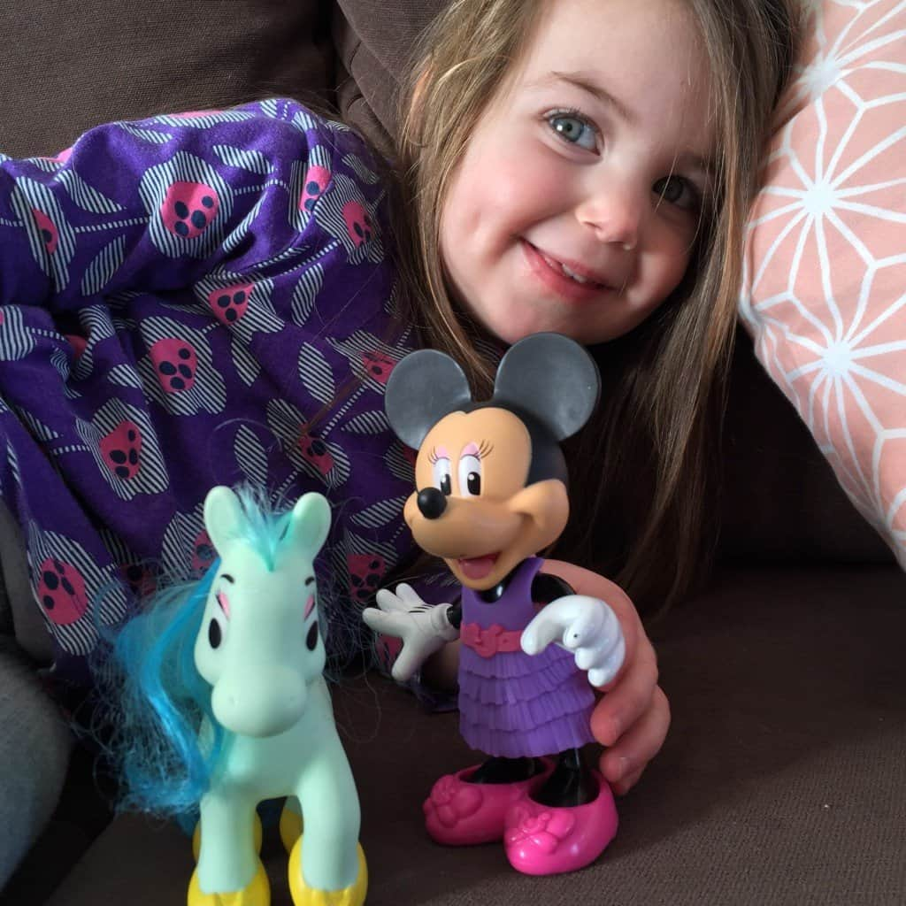 Thea and her Minnie Mouse figure