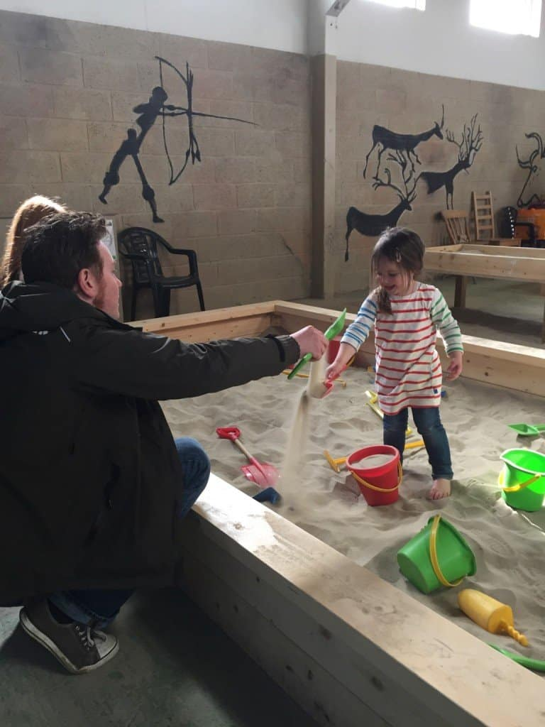 Thea and the sandpits at Green Dragon Eco Farm