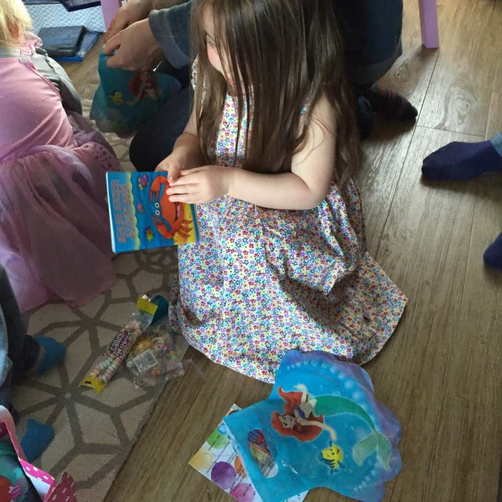 Thea opening her party bag from Party Bags & Supplies
