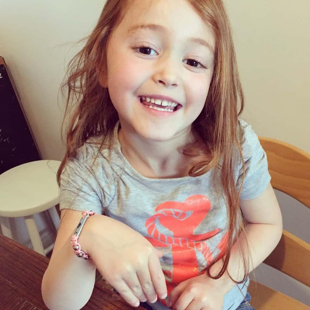 Ava and her pink MyBugle Pixie ID bracelet. JPG