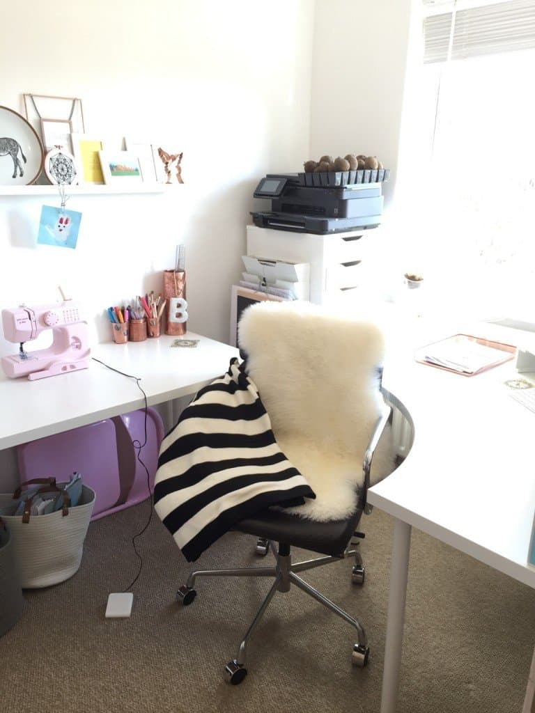 Our home office made cosy with a blanket and sheepskin rug