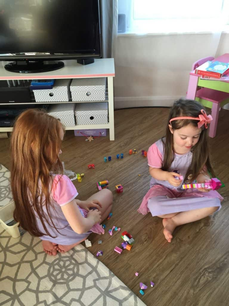 Ava and Thea playing with Lego