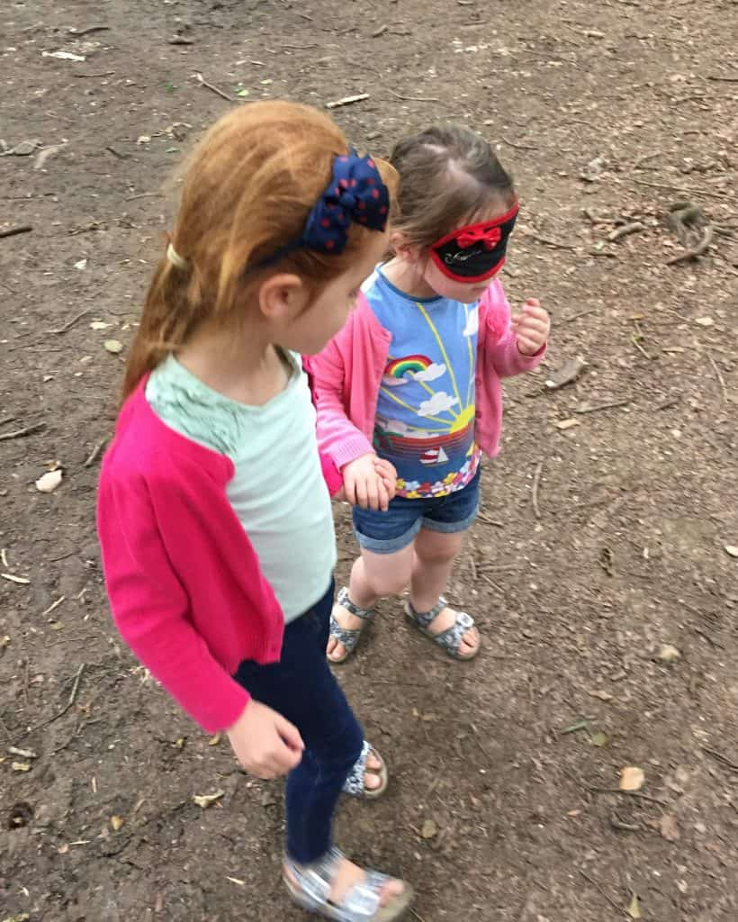Ava leading Thea around the forest