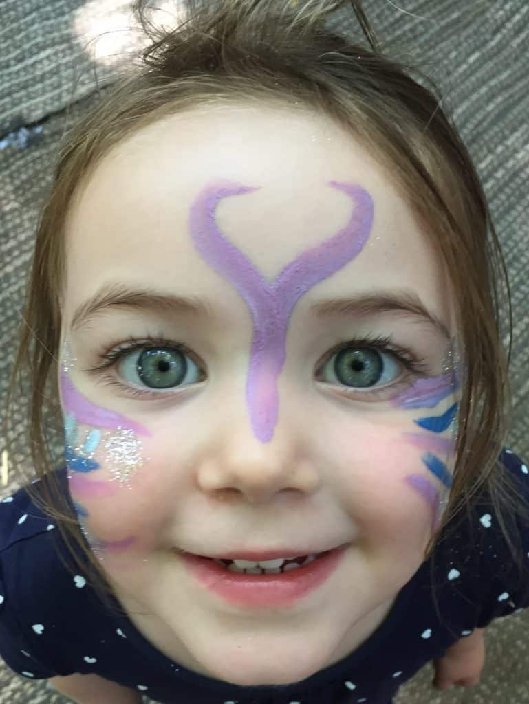 Glittery butterfly facpaint at The Wild Woodland Summer Ball