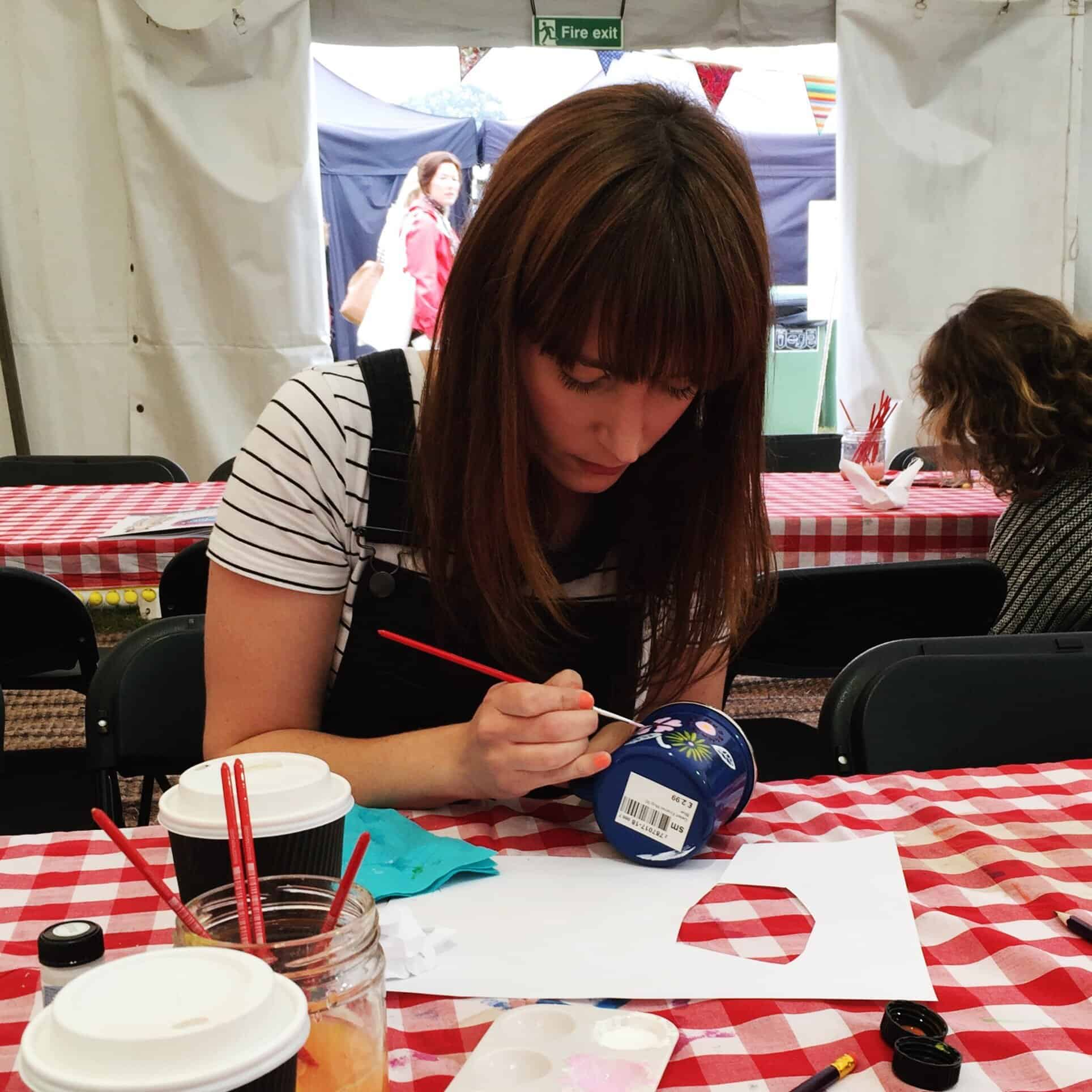 Becky painting a mug at The Lovely Drawer workshop at The Handmade Fair