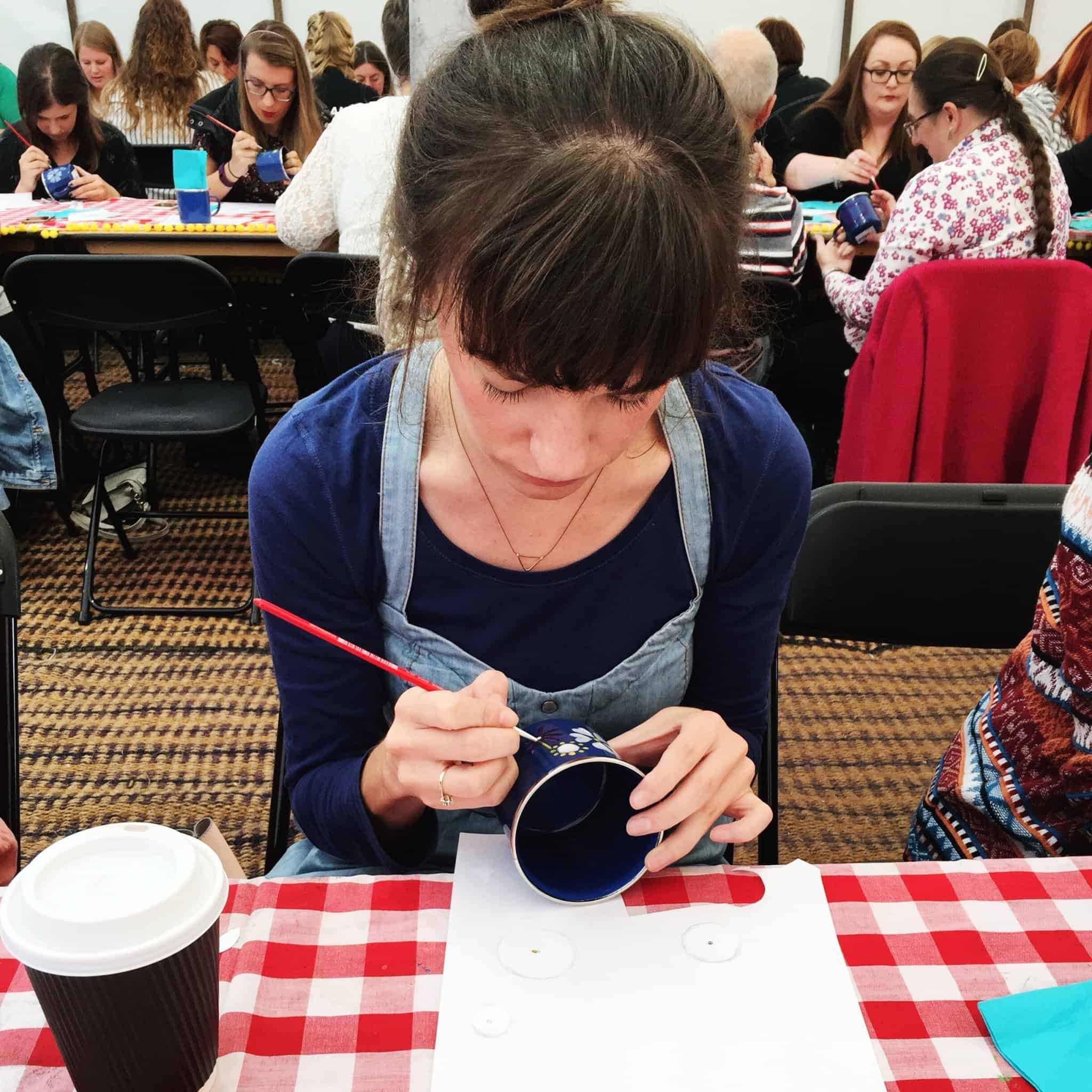 Debbie painting a mug at The Lovely Drawer workshop at The Handmade Fair