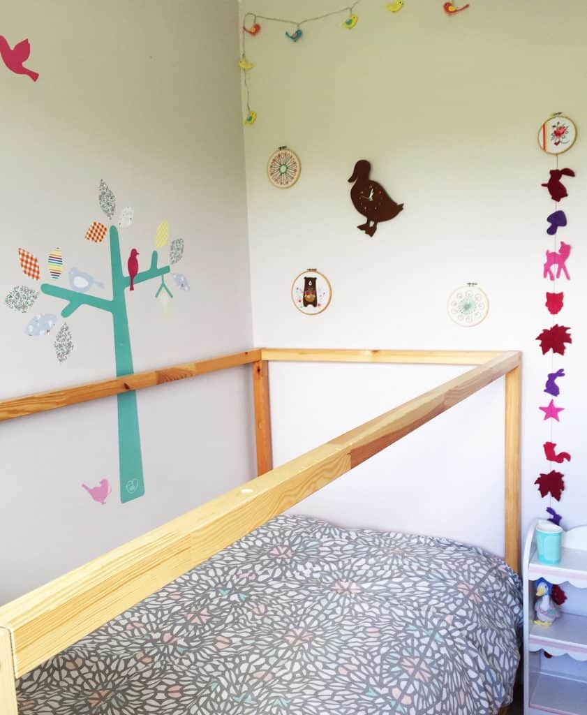 Ikea Kura Bed with grey duvet cover and Little Bird duck clock