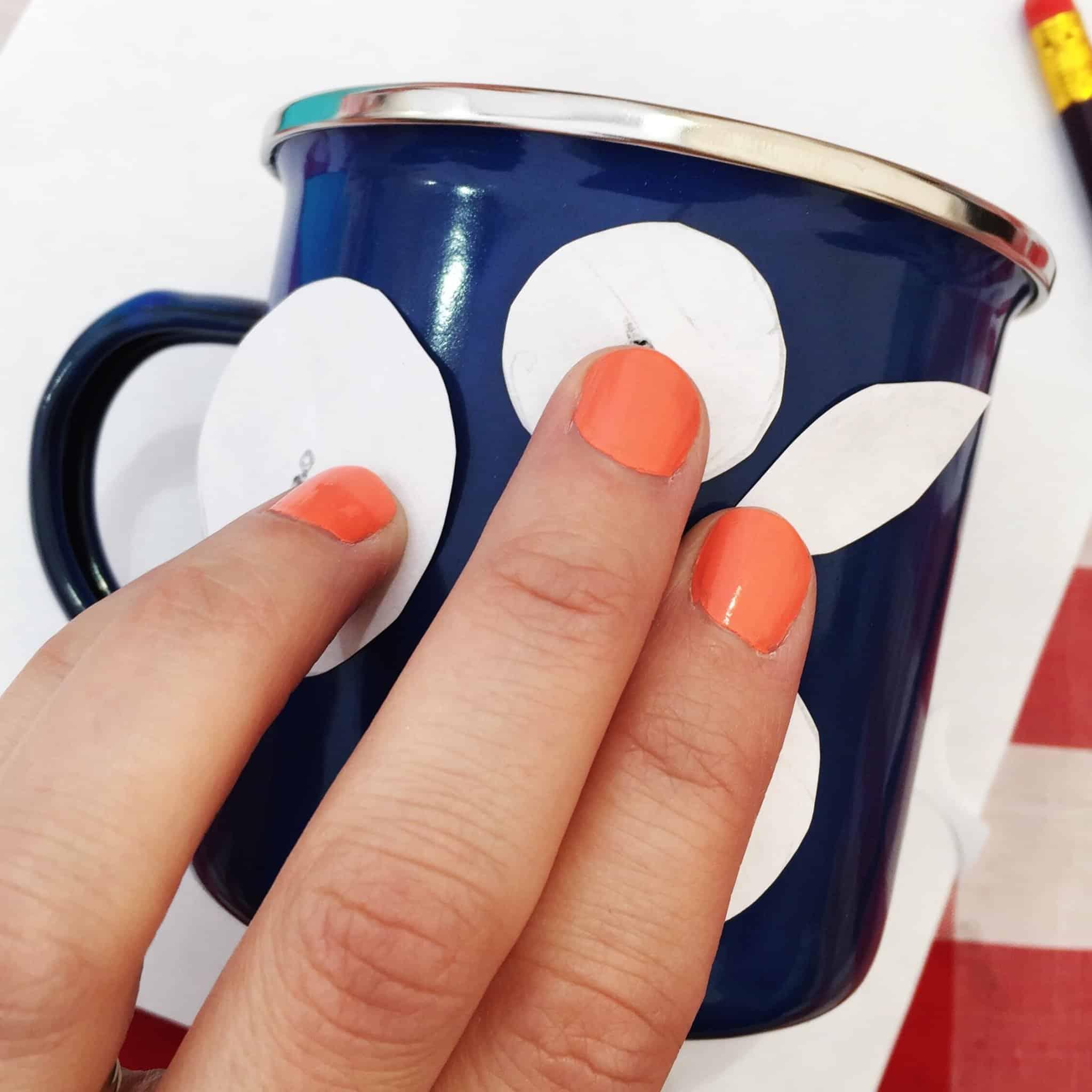 Positioning templates on enamel mug at The Handmade Fair 2016