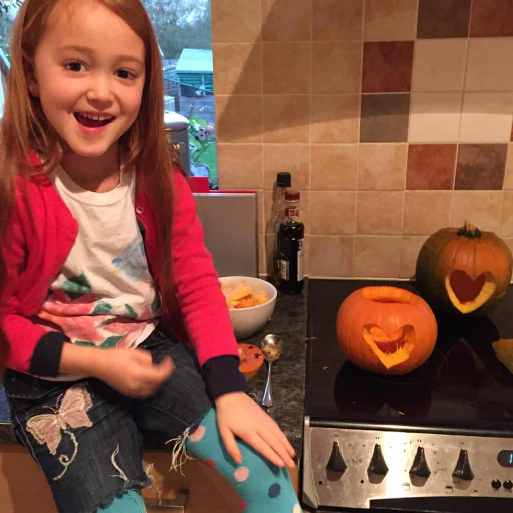Ava and her carved pumpkin for Carve a Heart