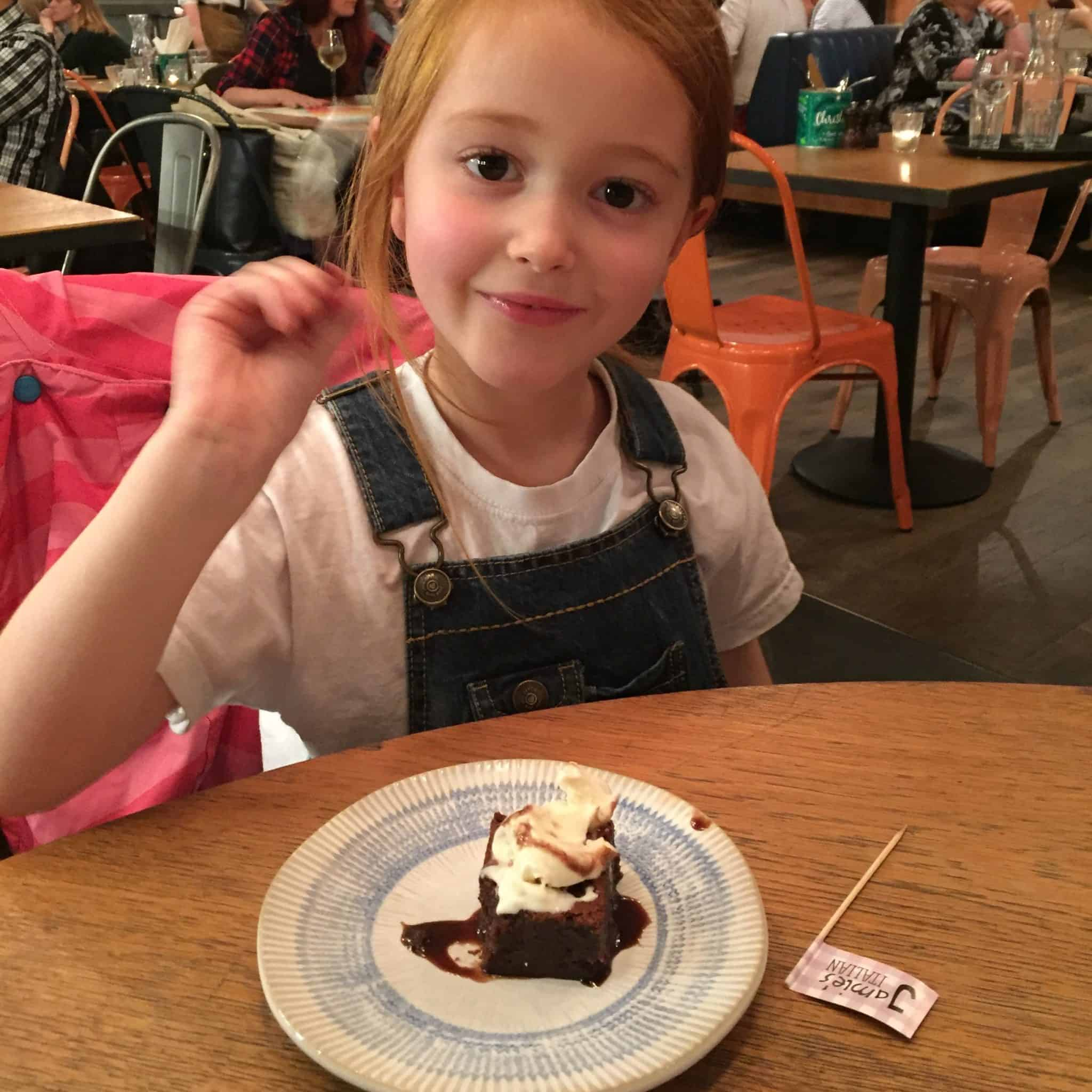 Ava enjoying her chocolate brownie at Jamies Italian in Milton Keynes