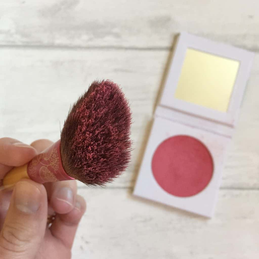 Blush brush loaded with PHB Ethical Beauty Pressed Blush brush loaded with Mineral Blusher in Camellia