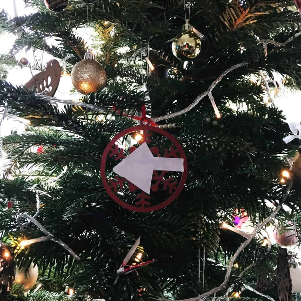 Arrow on a Christmas tree to show Santa the right way
