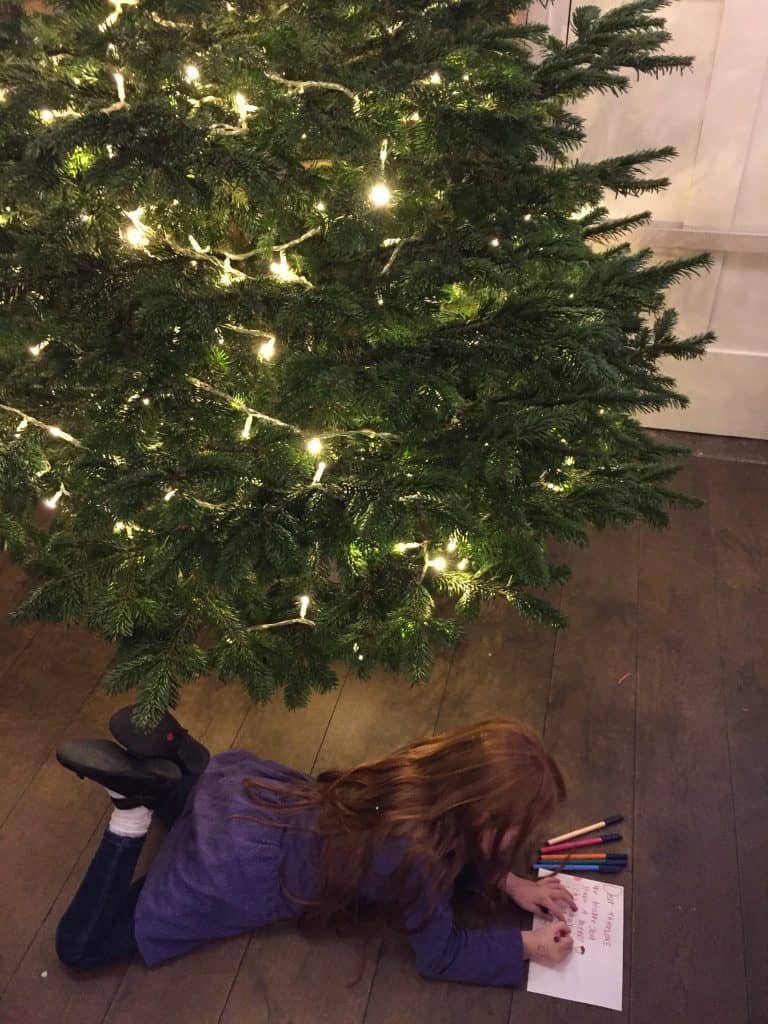 Ava colouring under a Christmas Tree at Make Wrap Mingle