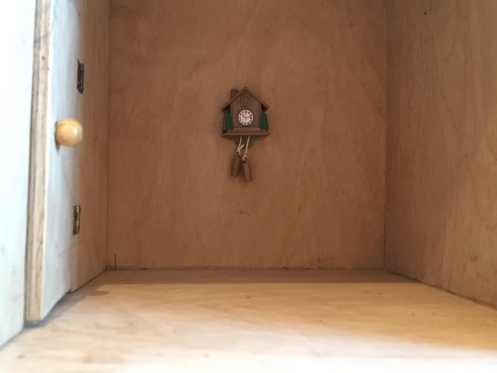 Empty dolls house with cuckoo clock