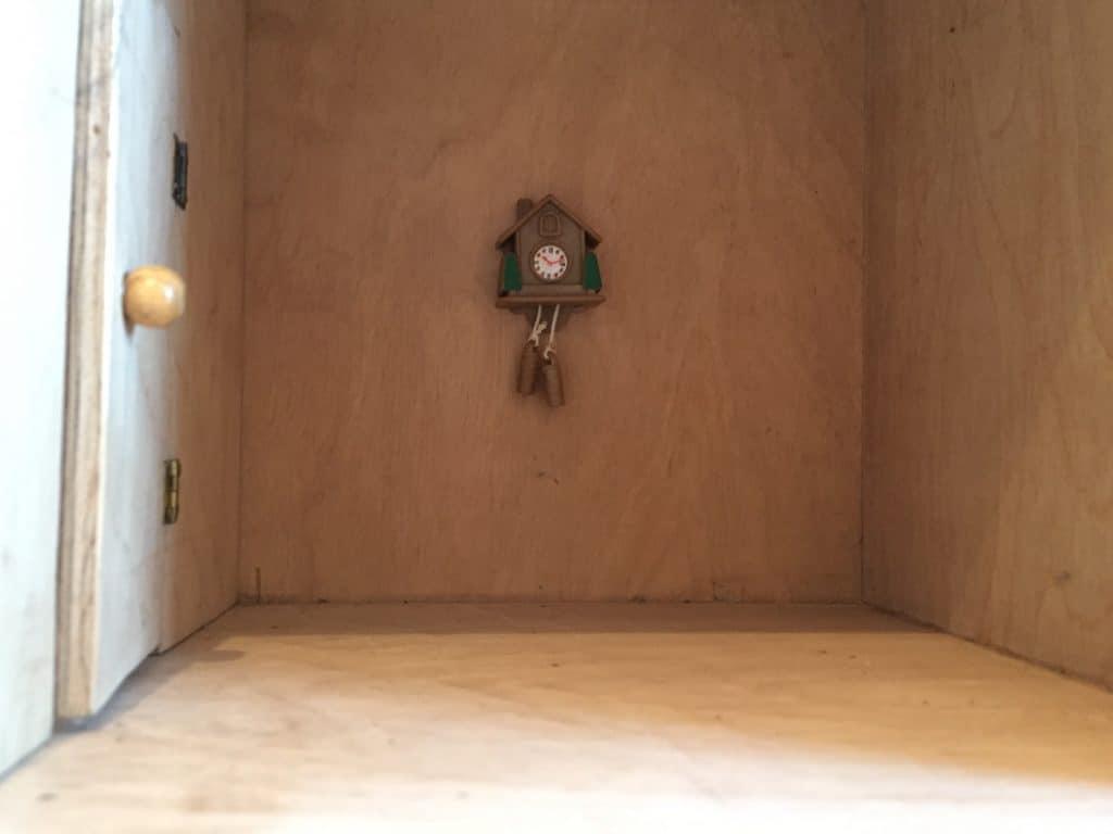 Empty dolls house with cuckoo clock