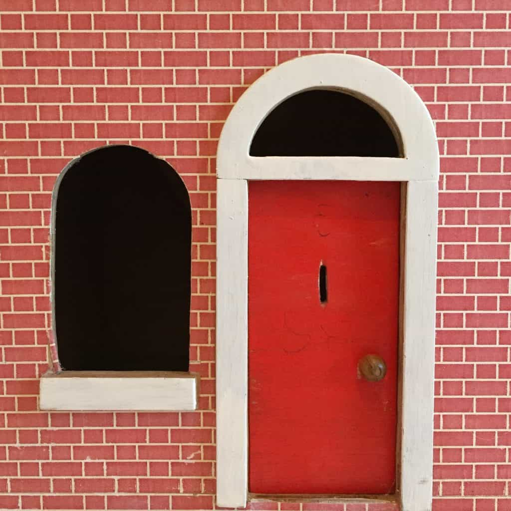 Red dolls house door and window
