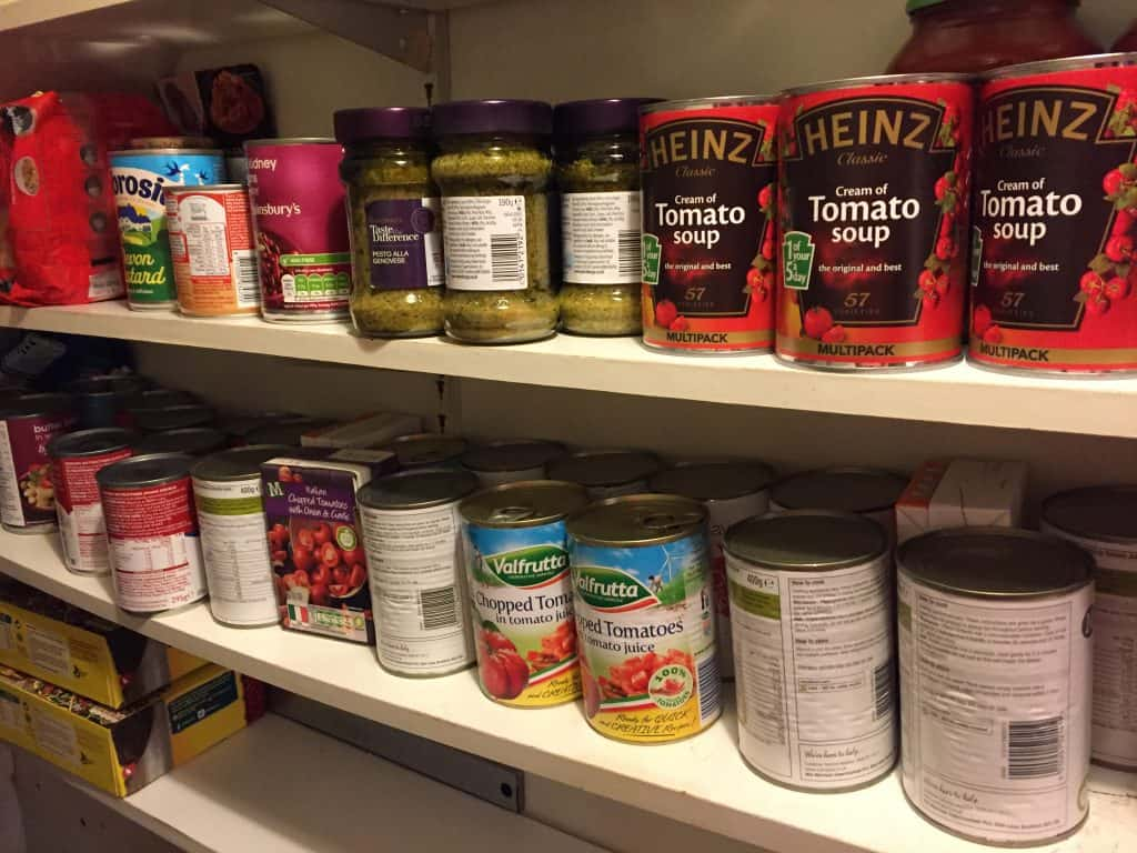 Pantry shelves with loads of cans of food
