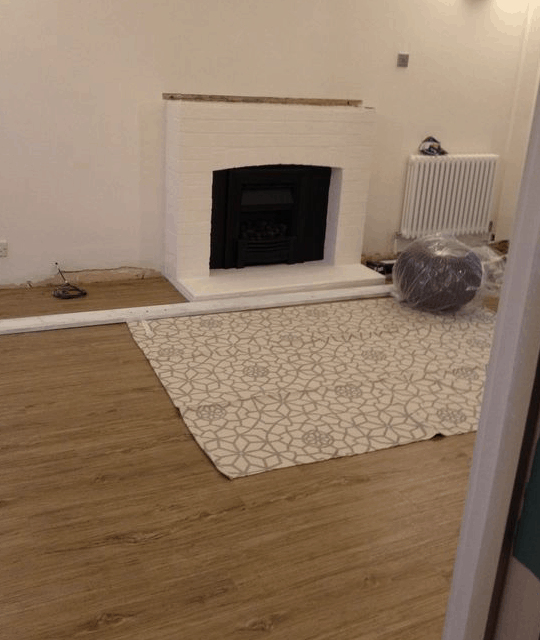 Lounge with wooden floor and white and grey rug