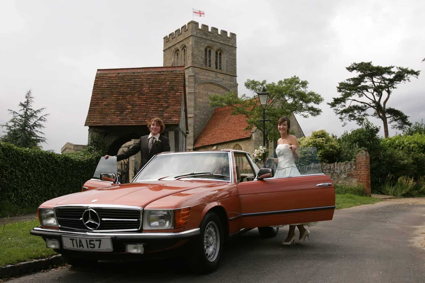 After the wedding, with a classic Mercedes