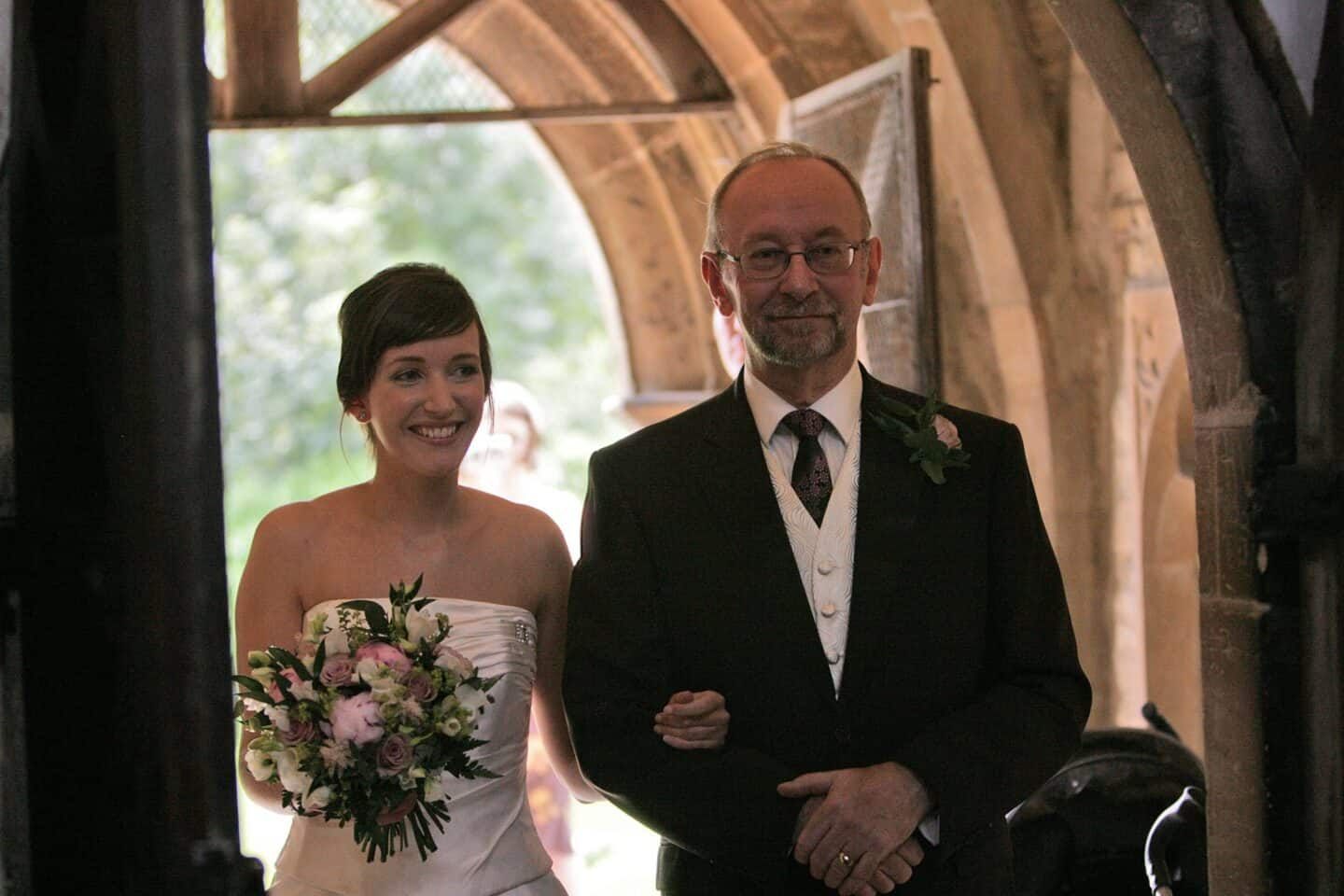 Becky Pink and her dad going into church on her wedding day