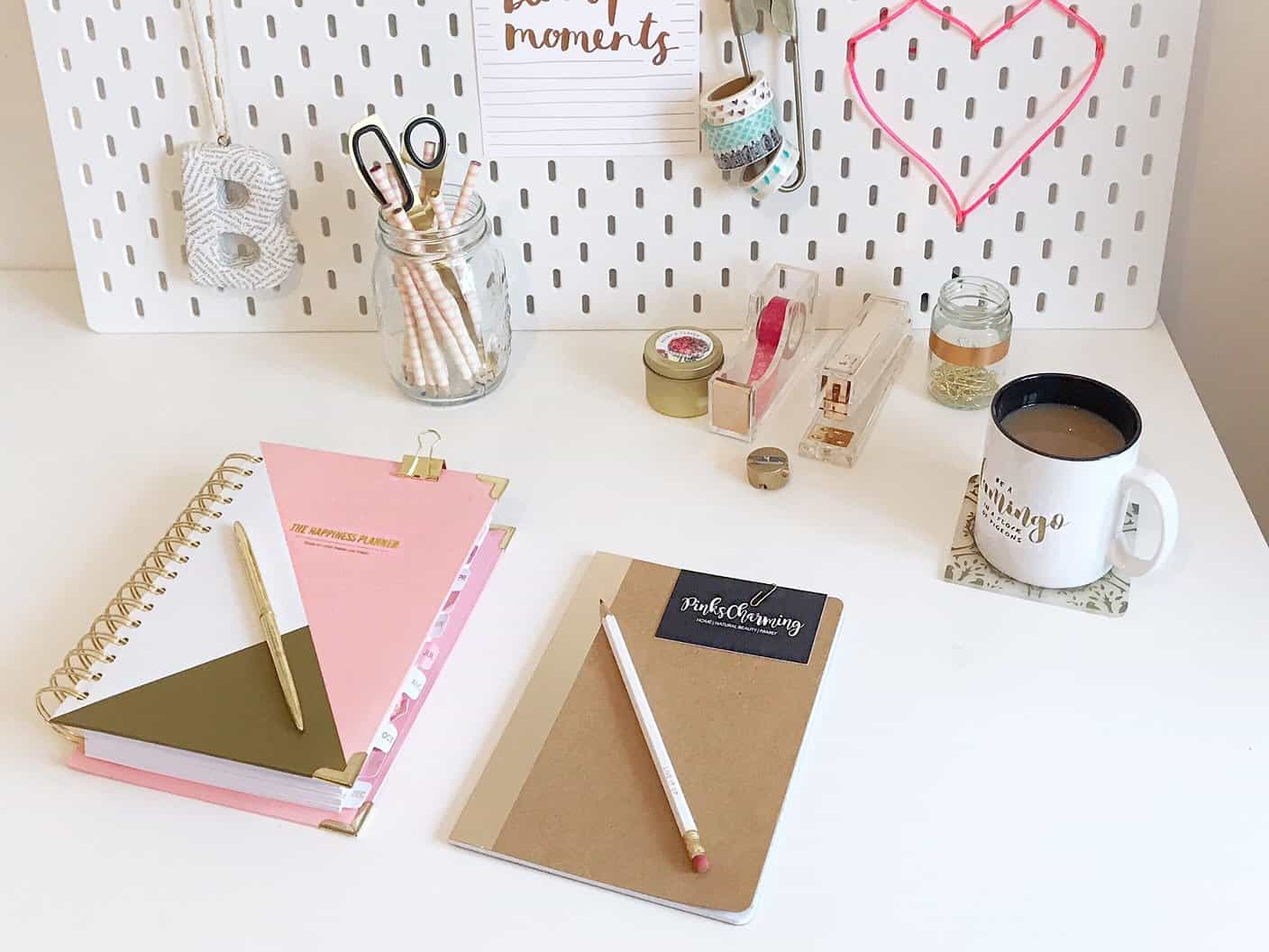 White Desk With Pink And Gold Accessories A Peg Board