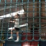 Thea climbing at the play barn