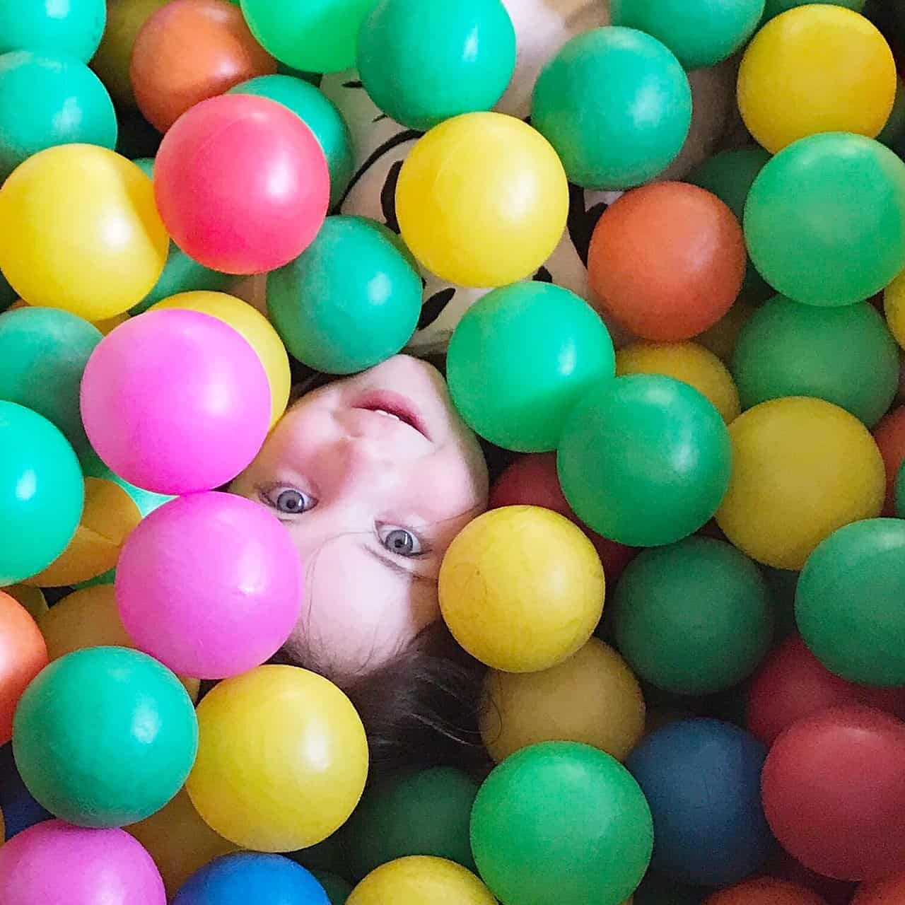 Thea in a ball pit at Gulliver's Land Theme Park Milton Keynes