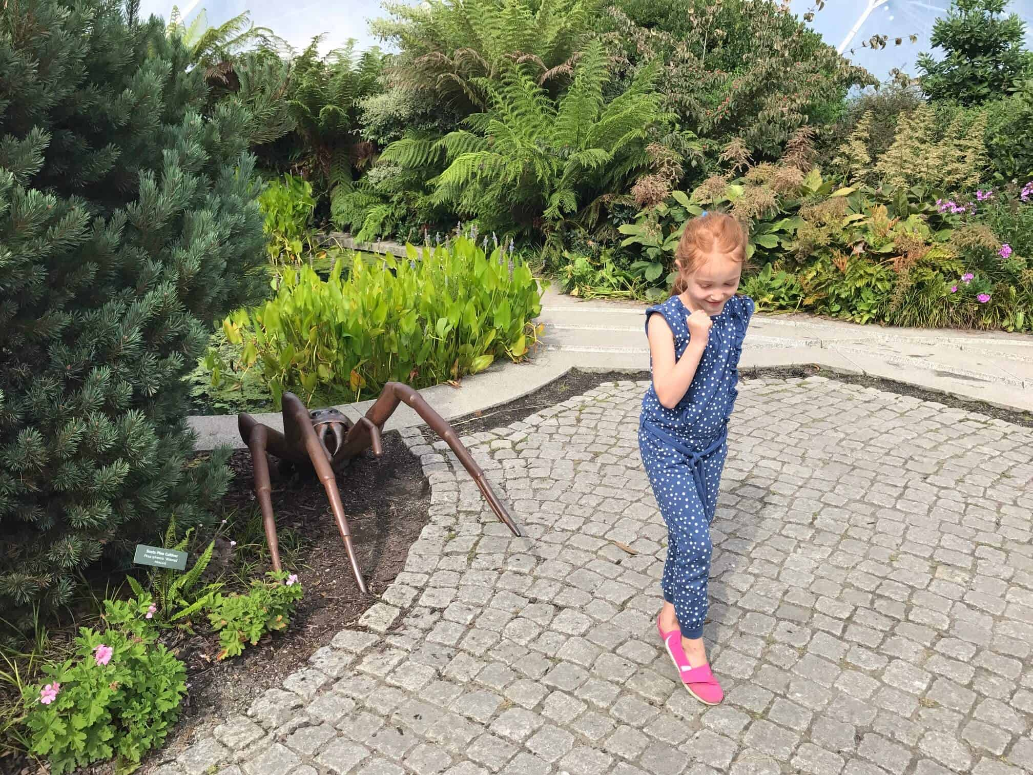 Ava running away from a giant spider
