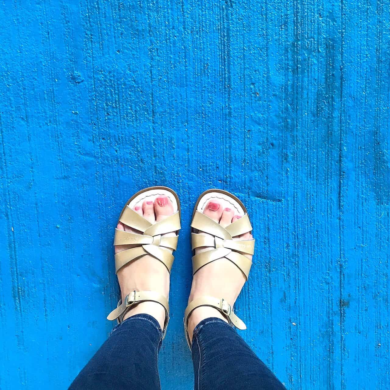 Original Gold Salt-Water Sandals on a blue floor