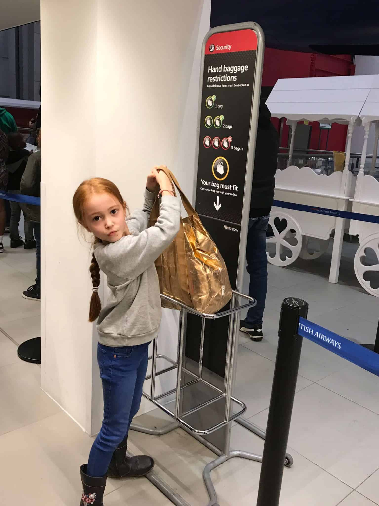 Checking if my bag fits into handluggage at Kidzania