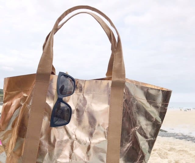 Sustainable Tote Bag in Rose Rose Gold by My Paper Tote with sunglasses on a beach