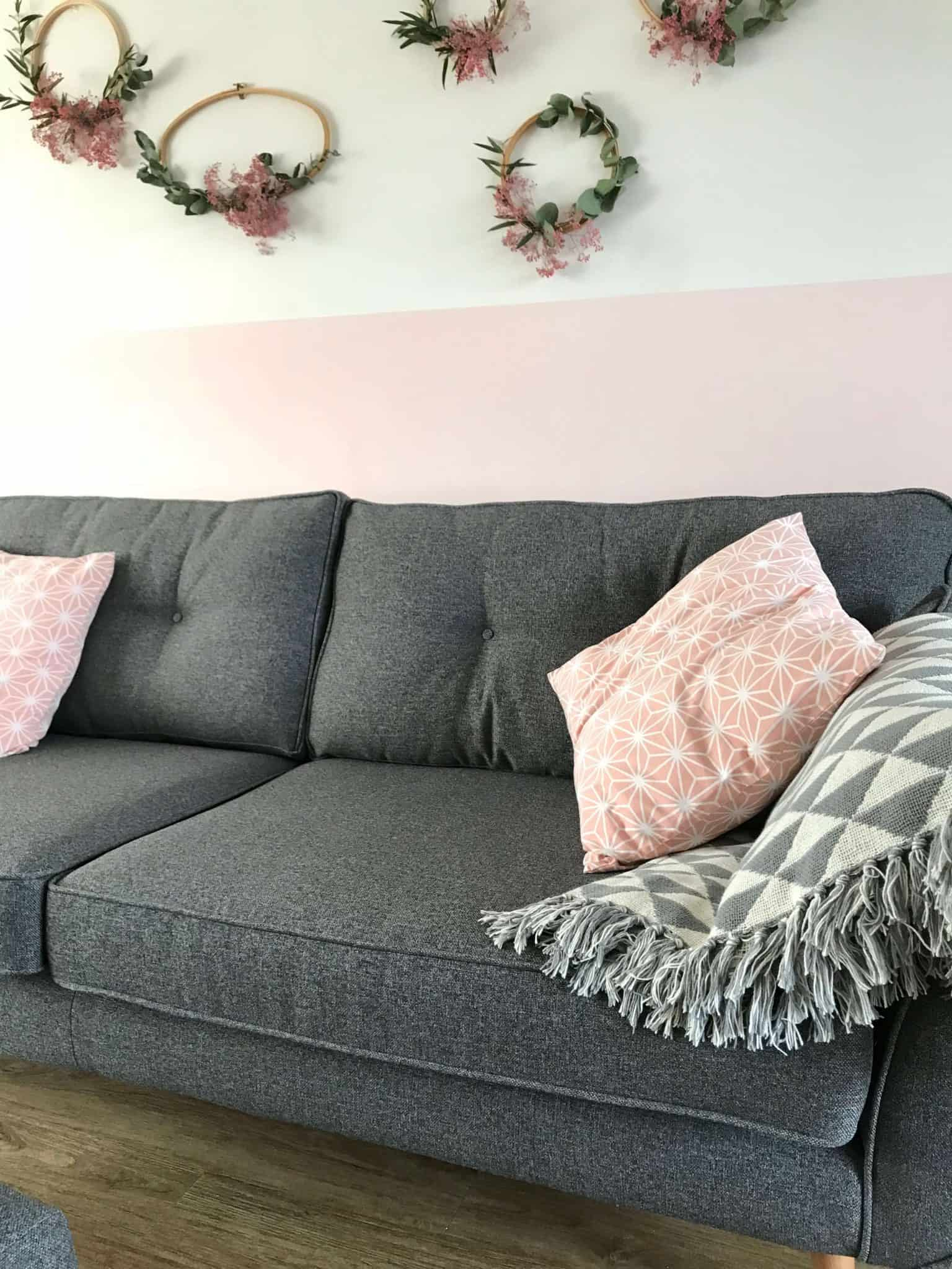 Charcoal Zinc DFS sofa with pink cushions and blanket