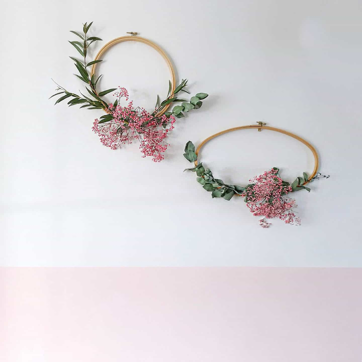 Winter wreaths with pink baby's breath and eualyptus on embroidery hoops