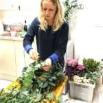 Jemma Gade from The Country Flower Company demonstrating how to make a contemporary Christmas wreath