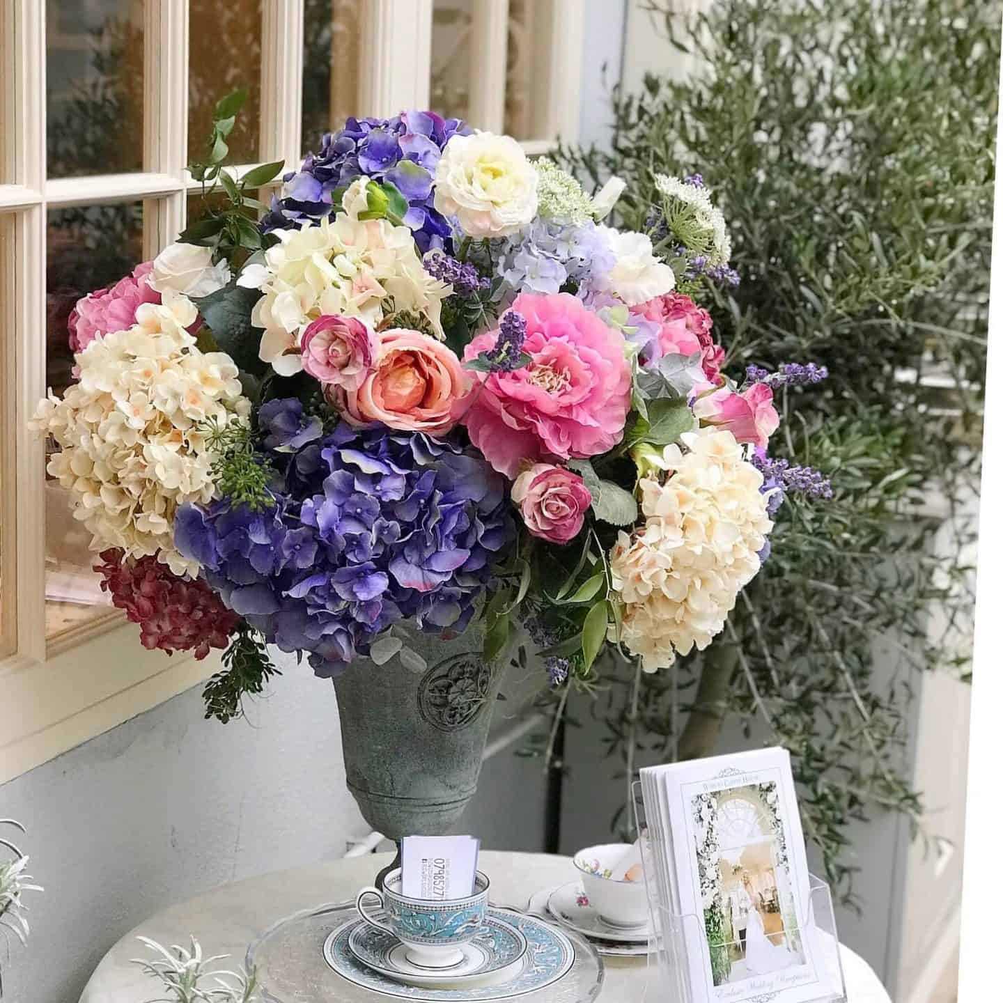 Pastel flowers in an urn